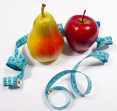 Apple, pear and tape measure, diet concept Stock Images