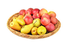 Apple and pear in a wattled basket Royalty Free Stock Photos