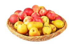 Apple and pear in a wattled basket Royalty Free Stock Images