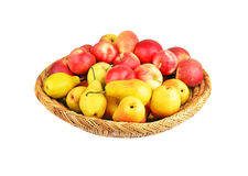 Apple and pear in a wattled basket Royalty Free Stock Photography