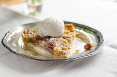 Apple pecan tart with ice cream Royalty Free Stock Photos