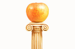 An apple on the pedestal Stock Photo