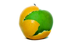 Apple with a peel from an orange. Green apple together with a peel from an orange (mixing of fruit Stock Photography