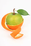 Apple in a peel from an orange. On a white background Royalty Free Stock Photography