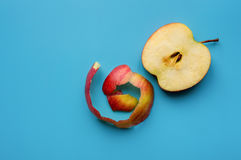 Apple with peel. Sliced fresh apple with peel on blue background. Top view Stock Image