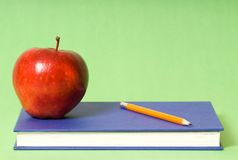Apple and pencil Stock Photography