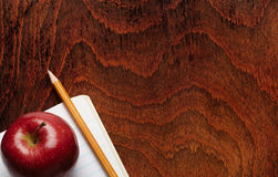 Apple and a pencil Stock Images