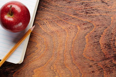 Apple and a pencil Royalty Free Stock Image