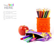 Apple and pencil-holders with copy space Stock Photos