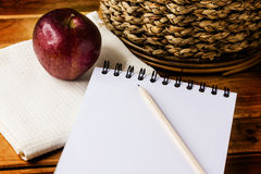 Apple,pencil and paper Stock Images