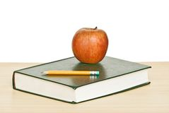 Apple and pencil on top of book Royalty Free Stock Photos