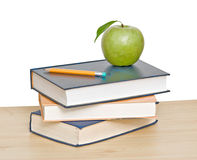 Apple and pencil on top of books Royalty Free Stock Photography