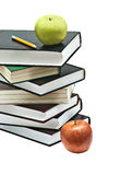 Apple and pencil on top of books Stock Images