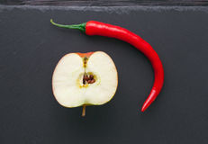 Apple and pepper on black stone Stock Photos