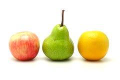 Apple, pera y naranja Imágenes de archivo libres de regalías