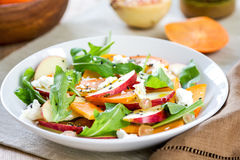 Apple with Persimmon and Feta salad stock photos