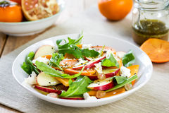 Apple with Persimmon and Feta salad Royalty Free Stock Images