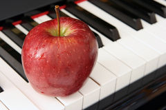 Apple and piano Royalty Free Stock Image