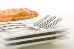 Apple Pie. Delicious home made apple pie with forks and plates Stock Image