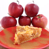 Apple Pie. A slice on a plate decorated with cinnamon and some red apples royalty free stock photos