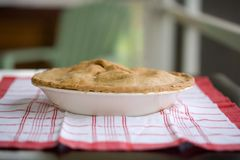 Apple Pie. Fresh Baked apple Pie on a red and white kitchen towel Royalty Free Stock Images