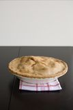 Apple Pie. Fresh Baked apple Pie on a red and white kitchen towel Stock Photos