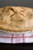 Apple Pie. Fresh Baked apple Pie on a red and white kitchen towel Royalty Free Stock Photo