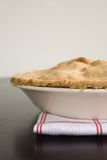 Apple Pie. Fresh Baked apple Pie on a red and white kitchen towel Royalty Free Stock Image
