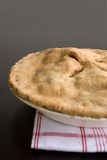 Apple Pie. Fresh Baked apple Pie on a red and white kitchen towel Royalty Free Stock Photography
