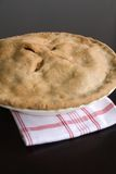 Apple Pie. Fresh Baked apple Pie on a red and white kitchen towel Stock Photo