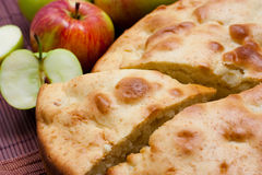 Apple pie. Freshly baked apple pie with apples in the background Royalty Free Stock Photo