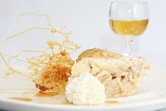 Apple pie. Beautifully decorated apple pie and dessert wine. Shallow depth of field, focus on the pie Stock Photo