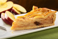Apple Pie. A slice of delicious apple pie with apple slices in the back (Selective Focus, Focus on the left front part Stock Photo