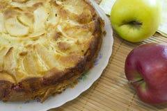 Apple pie. Plate with whole homemade apple pie Stock Photos