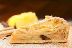 Apple Pie. A slice of delicious apple pie with sugar powder (Selective Focus, Focus on the upper edge of the pie Royalty Free Stock Photos