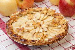 Apple Pie. Close up of apple pie, ripe apples, and candles Stock Photo