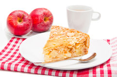 Apple pie. Plate of apple pie cake with coffee cup and apples Royalty Free Stock Image