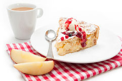 Apple pie. Plate of apple pie cake with ice, topping and coffee in background Royalty Free Stock Image