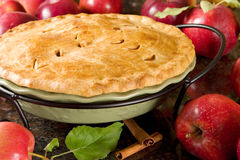 Apple pie. Homemade apple pie surrounded by fresh apples Royalty Free Stock Photo