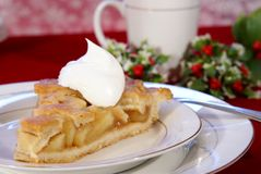 Apple Pie. Slice of apple pie with lattice crust, dollop of whipped cream, and coffee Stock Image