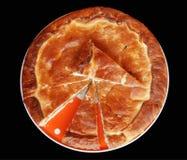 Apple pie. Sliced homemade apple pie isolated on black stock images