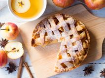Apple pie for afternoon tea meal. Homemade apple pie for afternoon tea meal in autumn season in top view Royalty Free Stock Image