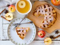 Apple pie for afternoon tea meal. Homemade apple pie for afternoon tea meal in autumn season on white wooden table in top view Stock Photo