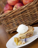 Apple Pie Ala Mode. On a wooden table Royalty Free Stock Photos