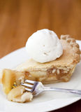 Apple pie alamode. On a wooden table Stock Photography