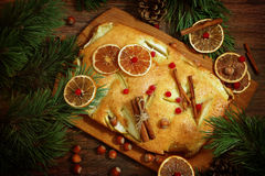 Apple pie with apples and cinnamon on a wooden table and fir bra Royalty Free Stock Photo