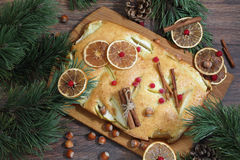 Apple pie with apples and cinnamon on a wooden table and fir bra Stock Photo