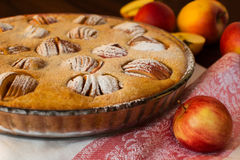 Apple pie and apples Stock Images