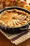 Apple pie. Arrangement of home-made apple pie and apples royalty free stock photo
