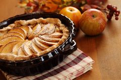 Apple pie. Arrangement of home-made apple pie and apples Stock Photography